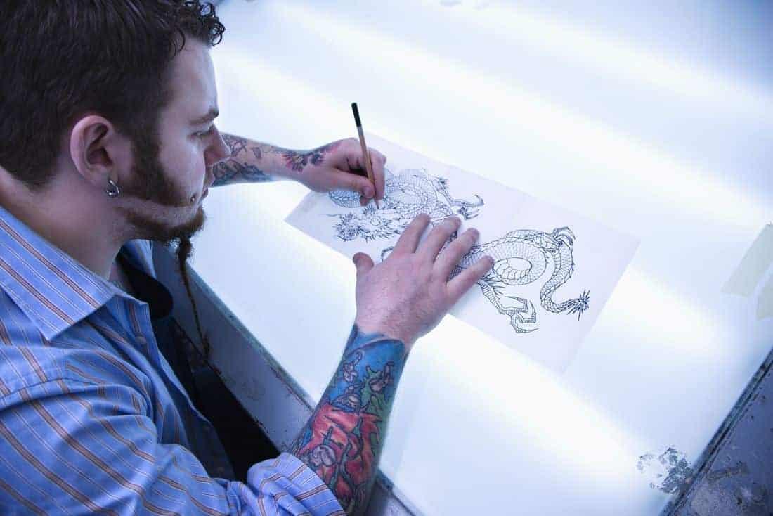 tattoo artist drawing
